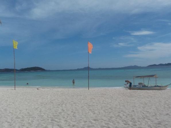 White sand beach at Malcapuya Island.